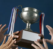 Holding up trophy Royalty Free Stock Images