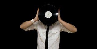 Holding-Vinylsatz des jungen Mannes Stockfoto