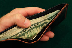 Holding a wallet Royalty Free Stock Photo