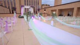 Holding wedding outdoor. Wedding ceremonyon. Dolly shot stock video