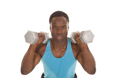 Holding weights on shoulder Stock Photography