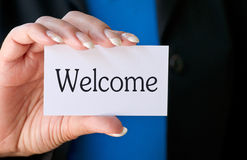 Holding a welcome card Stock Photography