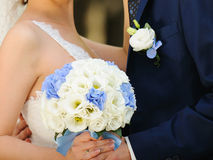 Holding White and Blue Bouquet Stock Photos