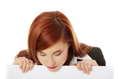 Holding white board Stock Image
