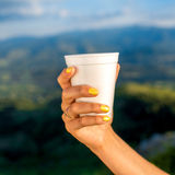 Holding white paper coffee cup Royalty Free Stock Photo