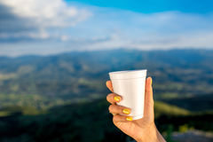 Holding white paper coffee cup Stock Images