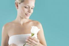 Holding white rose. Royalty Free Stock Image