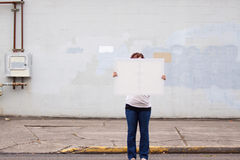 Holding White Sign Royalty Free Stock Photography
