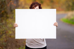 Holding White Sign Stock Images
