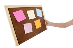 Holding a wooden board with multicolored notes Stock Photography