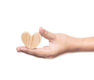 Holding wooden heart Royalty Free Stock Photo