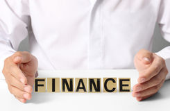 Holding word finance Stock Photo