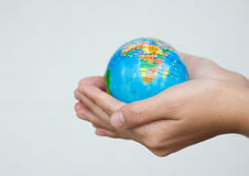 Holding world. A pair of hands holding and saving the world Stock Photo