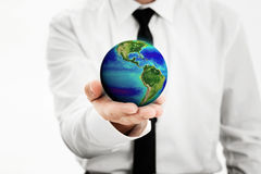 Holding world. Man holding a earth globe in his hand, Earth image provided by Nasa -http://www.nasa.go v/topics/earth/eart hday/gall_ocean_chr om.html Royalty Free Stock Photos