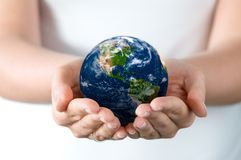 Holding world. A pair of hands holding and saving the world Stock Image