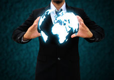 Holding a world Stock Photo