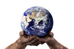 Holding the world with dirty hands Royalty Free Stock Images