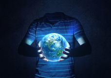 Holding the world. (Elements provided by nasa) Royalty Free Stock Image