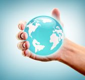 Holding world in hand Royalty Free Stock Photography