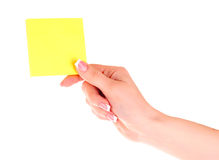 Holding a Yellow Note Stock Photo