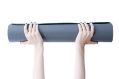 Holding a yoga mat Stock Images