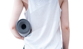 Holding a yoga mat Stock Photo