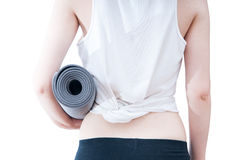 Holding a yoga mat Royalty Free Stock Photo