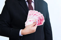 Holding Yuan or RMB, Chinese Currency Stock Photo