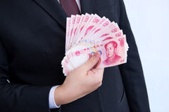 Holding Yuan or RMB, Chinese Currency Stock Images