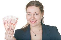 Holdingbargeld der jungen Frau in der Hand Stockbild