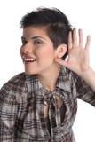 Holdinghand auf Ohr stockbild