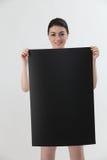 holdingkvinna för blankt kort Arkivbild