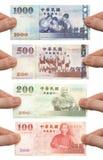 holdingpengar som är min på Royaltyfria Foton