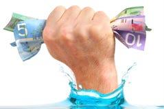 holdingpengar som är min på Royaltyfria Bilder