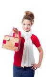 Holdingweihnachtsgeschenkbeutel der jungen Frau Stockfotografie