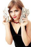 Holds the money. Young woman in the black dress holds the money Royalty Free Stock Photography