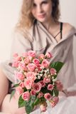 Holds out a bouquet of roses royalty free stock image