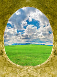 Hole. In with type on meadow and cloud Royalty Free Stock Images