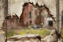 Hole. In old factory fence stock photos