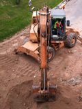 The hole. Digging machine digging a hole Royalty Free Stock Photos