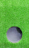 Hole at Artificial grass. Stock Images