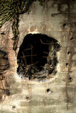 Hole from an artillery shel Royalty Free Stock Images