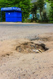 The hole in the asphalt on the road in the village. Royalty Free Stock Photos