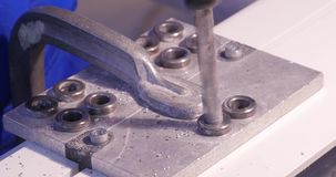 Hole being drilled into aluminium and metal using electric drill. Aluminium or metal drilling closeup in metal workshop stock footage
