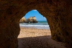 Hole of a big cave, Algarve Portugal. Hole of a big cave in the stones of the beach, Algarve Portugal Stock Photos