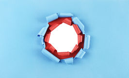 Hole in blue and red paper Royalty Free Stock Photos