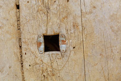 Hole in the board of the old weathered wood. Hole in the board of the old weathered gray wood Stock Photos