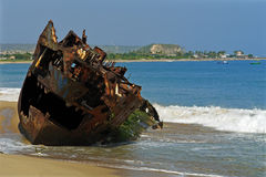 Hole boat. Shipwreck boat in the beach Stock Photos