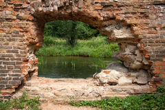 Hole in the brick wall. Ruins. old building. hole in the brick wall Royalty Free Stock Photo