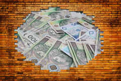 Hole in the brick wall showing the money Stock Image